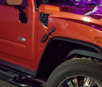 hummer-h2-limuzyny-weselne-kacprzak-limuzyny-lubne-limuzyna-hummer-orange-sun-set-lub-weseleorig
